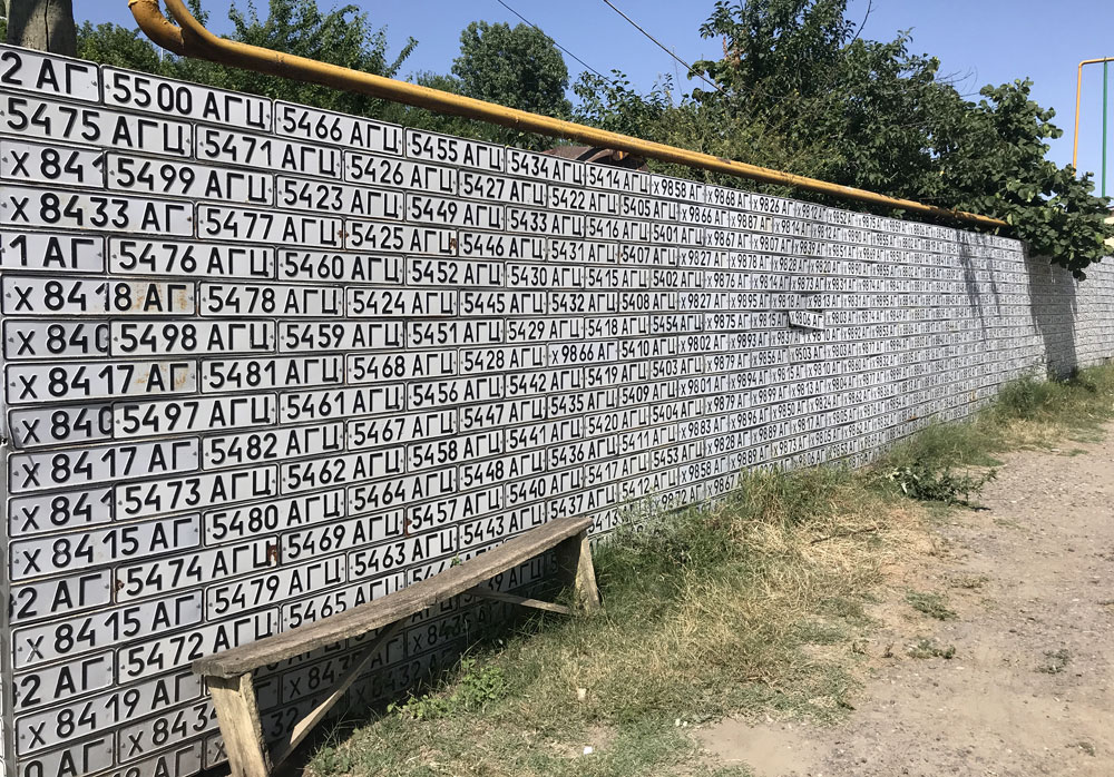 A wall of licence plates