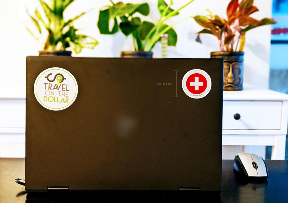 Flag Sticker - Switzerland on a laptop