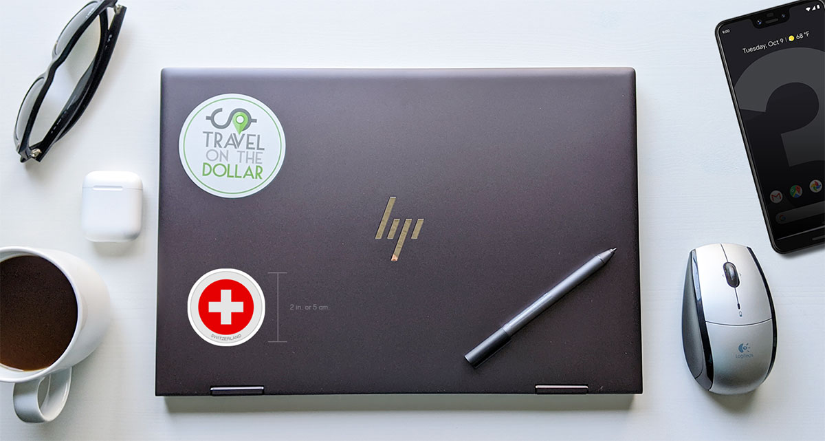 Flag Sticker - Switzerland on a laptop